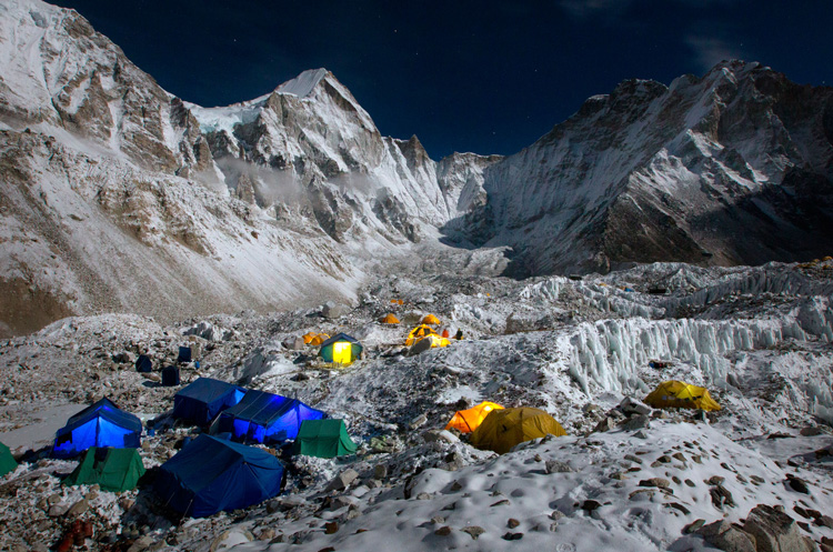 Everest Base Camp and the Khumbu Glacier glow beneath a full moon.